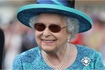 The Queen Sporting Sunglasses and an Umbrella Is the Most British Thing Ever