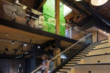 Industrial warehouse converted into open workplace with no private offices
